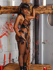 Ebony domina teases with a strapped dildo