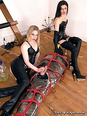 Two mistresses mummificated and bound slaveboy