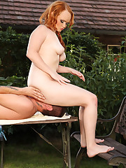 Cute fat redhead throning outdoors