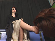 Mistress Mina catches her foot slave sniffing her shoes