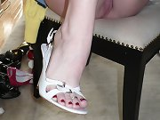 Rayveness takes her heels and fucks herself with a toy on a table
