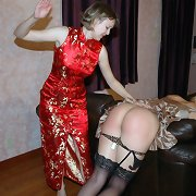 Sexy mother was spanking her daughter%uFFFDs bare ass.