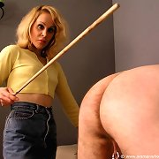Mature gal spanks slave