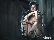 Nice girl in glasses confined in a very small cage.
