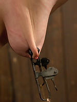Cherry Torn is bent over into pipe restraints and caned