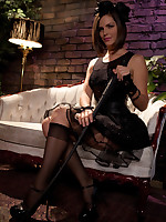 Elegant Mistress receives foot worship before donning strap-on