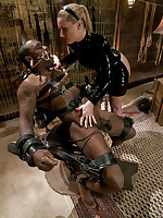 Severe bondage and CBT inflicted by latex-clad Domme