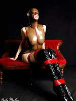 Emily Marilyn in rubber bound in red bondage tape wearing ballet boots