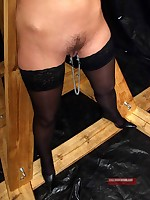 Slave in black stockings endures clamps and strict bondage