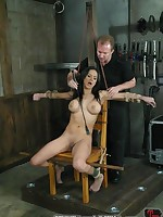 Slavegirl is bent over double, bound and fucked