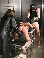 Two masked men dominate a bound girl