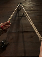 Girl is tied to the wall, legs in the air, forced to cum