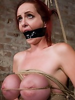 Redhead is hogtied, gagged and suspended