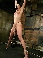 Pretty slavegirl in strict suspension