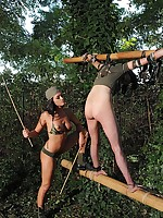Helpless submissive suspended outdoors between bamboo poles