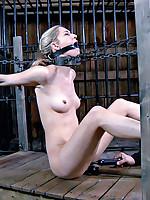 Pretty blonde submissive endures heavy iron collar and stocks