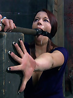 Submissive's fingernails are nailed to a post