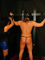 Submissive man is spanked and flogged while wearing hood