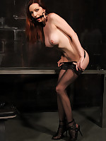 Lovely lady in stockings gagged until she drools