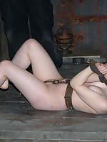 Slavegirl put through bondage paces including hogtie, upside-down suspension