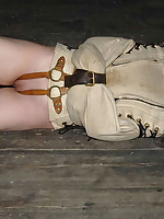 Slavegirl put through bondage paces including hogtie, upside-down suspension