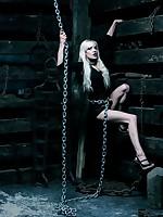 Sexy blonde locked behind bars
