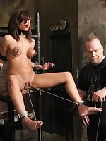 Slavegirl subjected to stocks, flogging, breast and clit pump