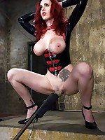 Redhead in latex blindfolded and disciplined