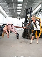 Blonde is bent over a forklift and ass-whipped