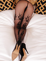 Titillating redhead Emily Marilyn mainly bed spreading legs through pantyhose