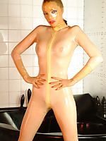 Emily Marilyn as A a rubber doll in transparent latex catsuit with the addition of hood