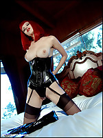 Emily Marilyn ~ fierce redhead in corset and stockings