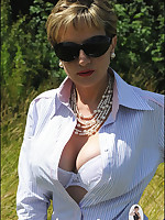 Domme in riding outfit dominates a man outdoors