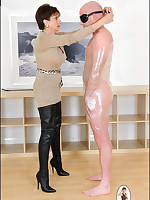 Domme in tall boots teases plastic-wrapped slaveboy