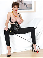 Pretty Domme with crop shows off her legs