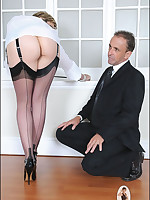 Domme in stockings tramples businessman