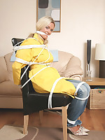 This glamorous blonde housewife is telegram fastened and gagged in so many different poses