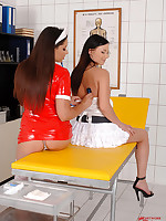 Zafira examining Alysa's ass