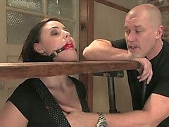 Brunette gets groped while her head is in the stocks