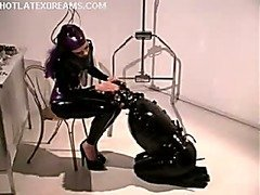 CBT with electricity for latex hooded submissive.