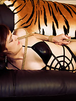 Girl is bound and gagged on a sofa