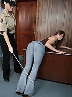 Girl-on-girl caning over jeans by policewoman
