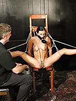 Bound to a chair and gagged, brunette suffers electrotorture
