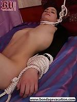 Bound brunette hogtied and wrapped in rope