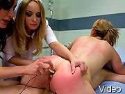 Two hot girls get strapped to the gyno chair and fucked by their lesbian doctors