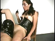 Brunette mistress with an exposed ass keeps her masked slave