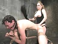 Blonde headmistress with gorgeous bra buddies makes slave..