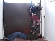 Blonde shoe trampling action on handsome guy