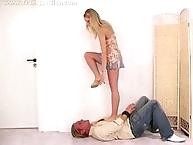 Jessy is treating a man with her sandal