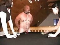 Mistress punching his ball by shooting  pool